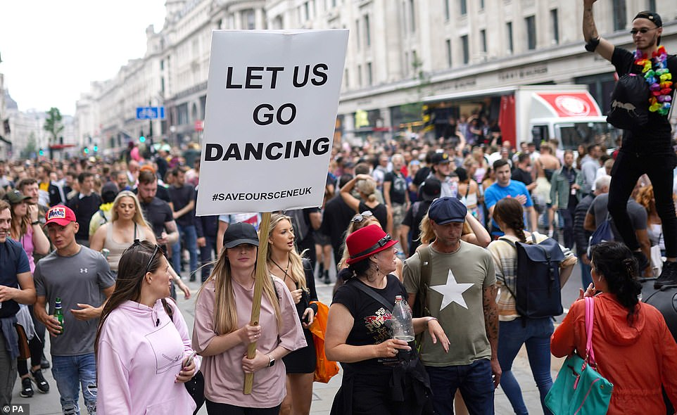 Maskless protesters gather at the 'Freedom To Dance' march